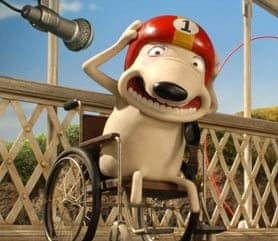 Aardman Creature Discomforts cartoon of a dog. He is sitting in a wheelchair and wearing a crash helmet