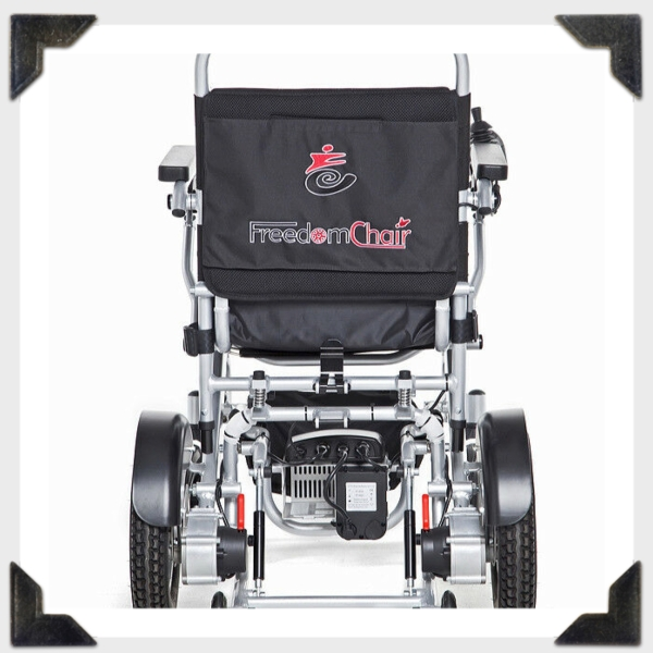 Photo of a freedom folding power wheelchair from the back. It shows the Freedom chair logo.
