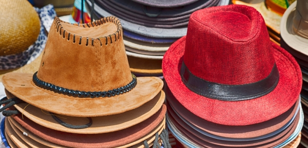 Piles of different coloured hats